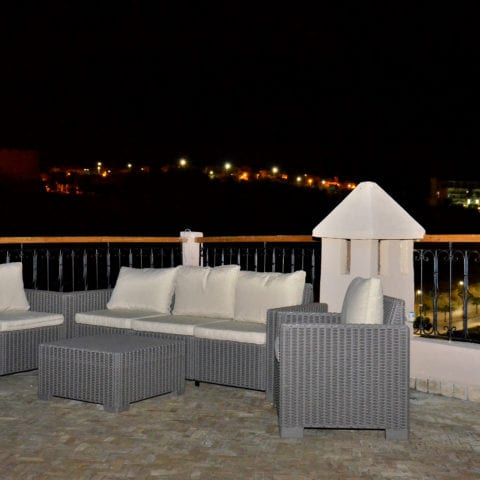 Rooftop lounge by night